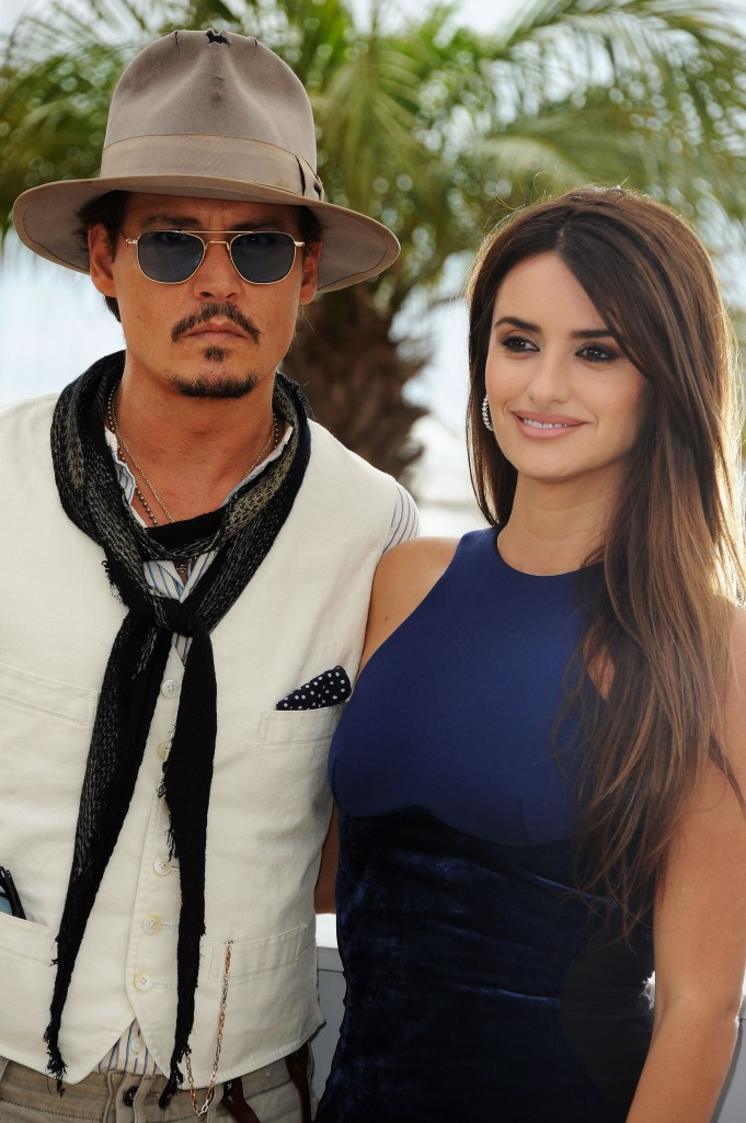 "Johnny Depp and Penelope Cruz attends the ""Pirates of the Caribbean: On Stranger Tides"" photocall at the Palais des Festivals during the 64th Cannes Film Festival on May 14, 2011 in Cannes, France."